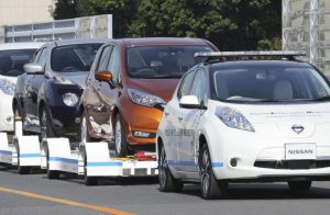 Nissan tests driverless car towing at Japanese plant