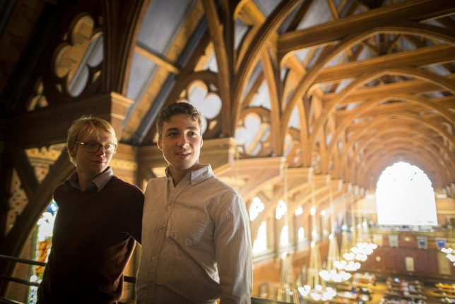 Harvard students Cole Scanlon (right) and Luke Richard-Ivar Heine put together a College Admissions and Financial Aid Guide to help increase access to college. They are pictured in Memorial Hall at Harvard University.